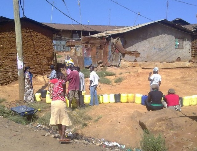 Residents collecting water in Kambi Muru